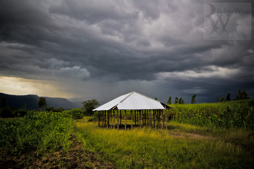 kenya nyanza kisumu wakesi development climate change photographer agriculture flooding iied dfid idrc acts uhai building church crops storm clouds 16350 Climate Change in the Nyando Basin   The Problem (IIED)